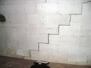 step crack in cinderblock foundation wall